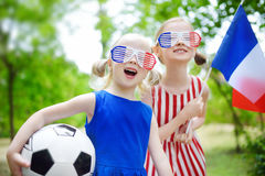 Two adorable little soccer fans cheering Royalty Free Stock Photography