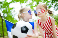 Two adorable little soccer fans cheering Royalty Free Stock Image