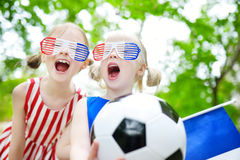 Two adorable little soccer fans cheering Royalty Free Stock Photo