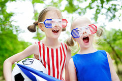 Two adorable little soccer fans cheering Stock Photo
