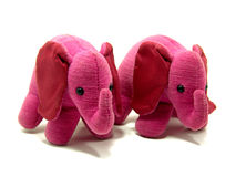 Two adorable pink elephant toys royalty free stock image