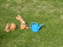 Two Rabbit Statues Green Grass Copy Space Royalty Free Stock Photography