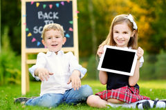 Two adorable schoolkids going back to school Royalty Free Stock Photography