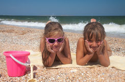 Two adorable toddler girl  on sand beach Stock Photo