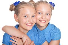 Two adorable twin sisters royalty free stock photography