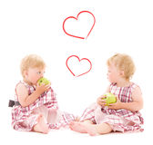 Two adorable twins over white Stock Photo
