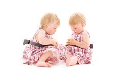 Two adorable twins over white Royalty Free Stock Photo