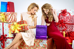 Two adorable women with Christmas gifts Royalty Free Stock Photos