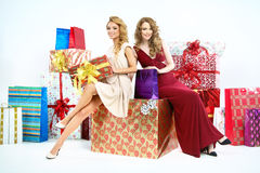 Two adorable women with plenty of Christmas gifts Stock Photography