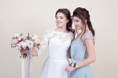 Two adorable women wearing in long fashionable dresses Royalty Free Stock Photography