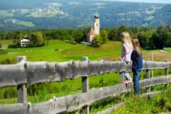Two adorables little sisters admiring beautiful landscape in Dolomites mountain range, South Tyrol, Italy Royalty Free Stock Photography