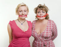 Two adult fat women hostages tied up with the mout Royalty Free Stock Image