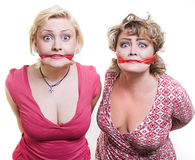 Two adult fat women hostages tied up with the mout Stock Photography
