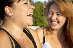 Two adult girls laughing Royalty Free Stock Photos