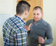 Two adult males fighting indoor Royalty Free Stock Photos