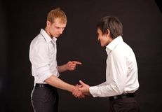 Two adult man in business hand shake on black back Royalty Free Stock Photography