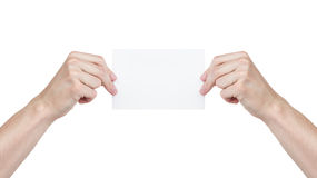 Two adult man hands holding blank paper sheet. Isolated on white Stock Photography