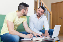 Two adult men with laptop indoors Royalty Free Stock Photo