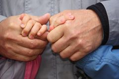 Two adult and two children's hands Royalty Free Stock Photos
