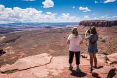 Two adult woman mother and daughter enjoy the scenic view of the Canyonlands National Park in Utah stock images