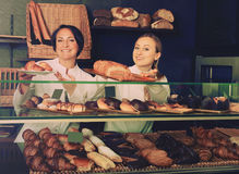 Two adult women with desserts in the pastry shop Stock Photos