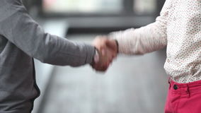 Two advertising executives shaking hands stock footage