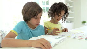 Two African American Children Doing Homework In Kitchen stock footage