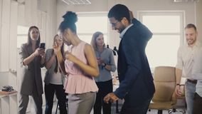 Two African American friends doing dance moves together at office party. Multiethnic business people have fun at work 4K. Young happy smiling colleagues share stock video