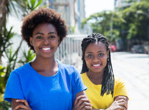 Two african american girlfriends with crossed arms Royalty Free Stock Images