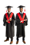 Two african american graduates in gown and cap Stock Photography