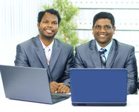 Two african-american in the office work of the laptop. Stock Photography