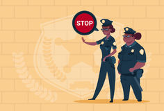 Two African American Police Women Holding Stop Sign Wearing Uniform Female Guards On Blue Bricks Background Stock Photos