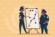 Two African American Police Women Planning Action On White Board Wearing Uniform Female Guards On Blue Bricks Background Royalty Free Stock Photos