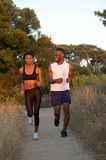 Two african american runners exercising outdoors Stock Photo