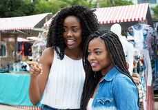 Two african american woman shopping at market Royalty Free Stock Image