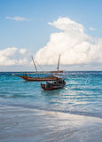 Two african boats near the shore with beautiful sea and sky on the background Stock Photo