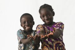 Two African children showing their palms asking begging for some Royalty Free Stock Photos