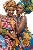 Two African fashion models on white background. Royalty Free Stock Images