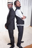 Two african guys back to back.  Royalty Free Stock Photo