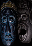 Two African Masks. Against A Black Background Royalty Free Stock Image