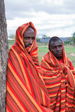 Two African men. MASAI MARA, KENYA - DECEMBER 28: Two unidentified African men pose for a portrait on December 28, 2009 in Masai Mara, Kenya. The Masai are a Royalty Free Stock Photos