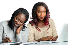 Two african teen students doing homework. Royalty Free Stock Photos