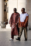 Two africans with characteristic clothes. Walking in St. Peter in the Vatican City in Rome (Italy royalty free stock image