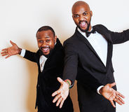 Two afro-american businessmen in black suits emotional posing, g Stock Photography