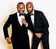 Two afro-american businessmen in black suits emotional posing, gesturing, smiling. wearing bow-ties. Close up Royalty Free Stock Photography