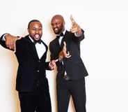 Two afro-american businessmen in black suits emotional posing, gesturing, smiling. wearing bow-ties close up, lifestyle. People concept copyspace Stock Images