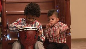 Two afro boys play music. Kids playing music on stairs. Creative duet of young musicians. Starting a music tour stock video