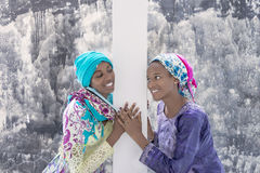 Two Afro teenagers smiling at each other Royalty Free Stock Photos