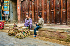 Two aged men discuss in the street, Kathmandu, Nepal Royalty Free Stock Photography