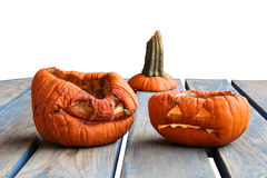 Two aged pumkins on a table Stock Photography